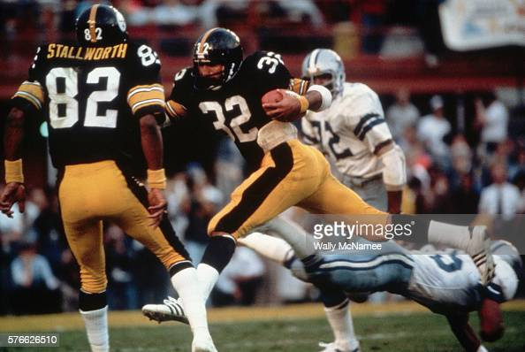 Pittsburgh Steeler running back Franco Harris slashes through the Dallas Cowboy defense on the way to his team's winning the Super Bowl 3531