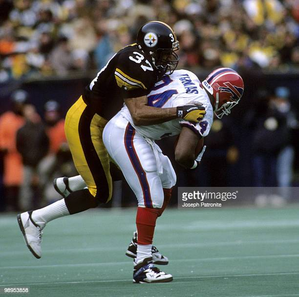 Pittsburgh Steelers defensive back Carnell Lake tackles Buffalo Bills running back Thurman Thomas during the Steelers 4021 victory over the Buffalo...