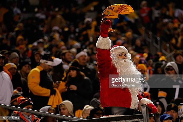 Pittsburgh Steelers fan dressed as Santa Claus waves a terrible towel in the third quarter of the game against the Denver Broncos at Heinz Field on...