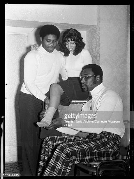 Pittsburgh Steelers football players Dwight White and LC Greenwood wrapping ankle of Carla Jean Arter in William Penn Hotel during Female Football...
