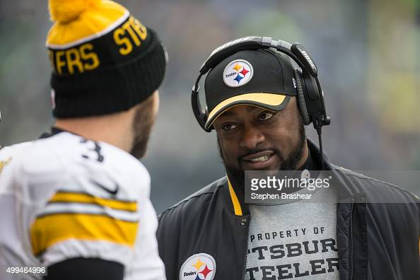 Pittsburgh Steelers head coach Mike Tomlin right talks with quarterback Landry Jones of the Pittsburgh Steelers on sidelines during a football game...