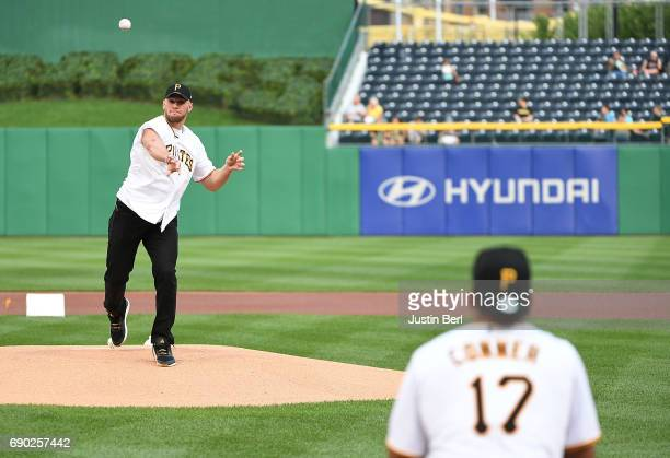 Pittsburgh Steelers linebacker TJ Watt and running back James Conner participate in throwing out the first pitch before the game between the...