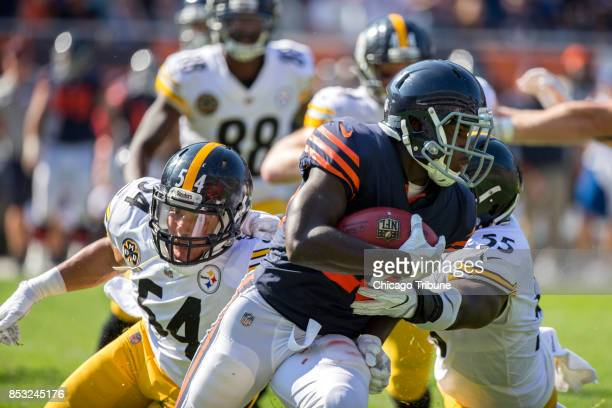 Pittsburgh Steelers linebackers LJ Ford and Arthur Moats close in on Chicago Bears running back Tarik Cohen during the fourth quarter at Soldier...
