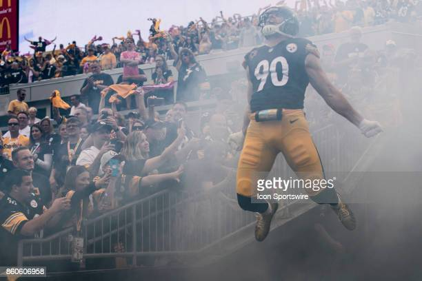 Pittsburgh Steelers outside linebacker TJ Watt leaps in the air screaming while taking the field during the game between the Jacksonville Jaguars and...