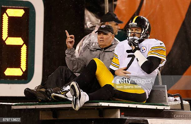 Pittsburgh Steelers quarterback Ben Roethlisberger is taken off the field injured after being sacked by Cincinnati Bengals' AJ Hawk during the second...