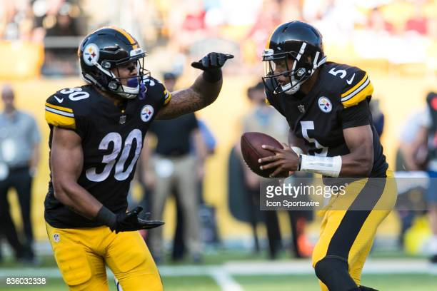 Pittsburgh Steelers Quarterback Joshua Dobbs fakes a handoff to Pittsburgh Steelers Running Back James Conner during a preseason game between the...