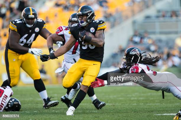 Pittsburgh Steelers Running back James Conner carries the ball during a preseason game between the Atlanta Falcons and the Pittsburgh Steelers on...