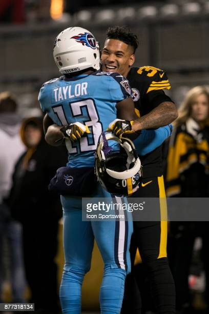 Pittsburgh Steelers Running Back James Conner hugs Tennessee Titans Wide Receiver Taywan Taylor during the game between the Tennessee Titans and the...