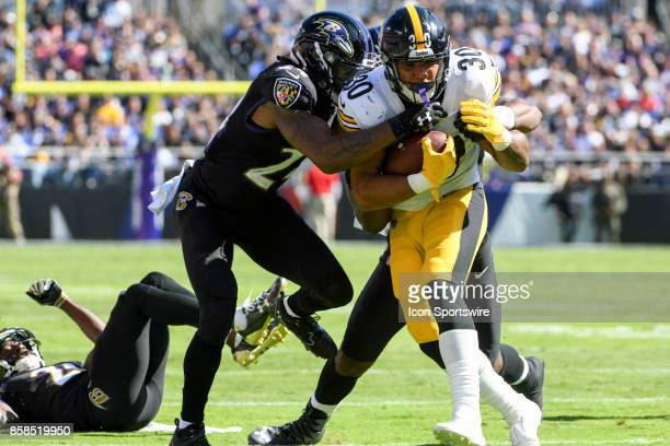 Pittsburgh Steelers running back James Conner in action against Baltimore Ravens cornerback Brandon Carr on October 1 at MT Bank Stadium in Baltimore...