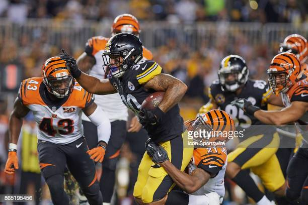 Pittsburgh Steelers running back James Conner is tackled by Cincinnati Bengals cornerback Darqueze Dennard during an NFL game between the Cincinnati...