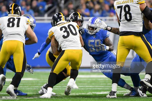 Pittsburgh Steelers running back James Conner runs into the tackle by Detroit Lions outside linebacker Tahir Whitehead during the Detroit Lions game...