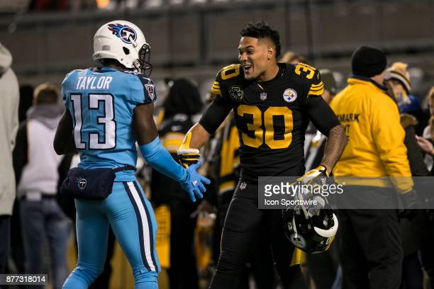 Pittsburgh Steelers Running Back James Conner shakes hands with Tennessee Titans Wide Receiver Taywan Taylor during the game between the Tennessee...