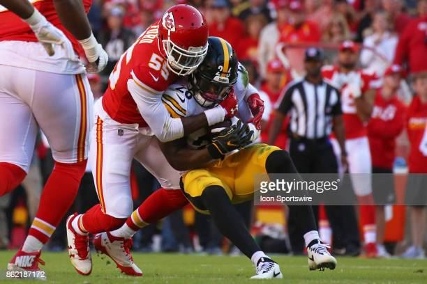 Pittsburgh Steelers running back Le'Veon Bell is wrapped up by Kansas City Chiefs outside linebacker Dee Ford in the second quarter of a week 6 NFL...