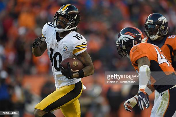 Pittsburgh Steelers wide receiver Martavis Bryant picks up a big gain as he gets chased by Denver Broncos strong safety TJ Ward during the third...
