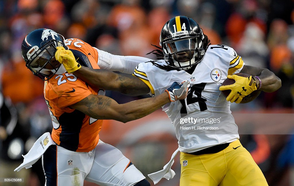 Pittsburgh Steelers wide receiver <a gi-track='captionPersonalityLinkClicked' href=/galleries/search?phrase=Sammie+Coates&family=editorial&specificpeople=9689097 ng-click='$event.stopPropagation()'>Sammie Coates</a> (14) stiff arms Denver Broncos cornerback <a gi-track='captionPersonalityLinkClicked' href=/galleries/search?phrase=Chris+Harris+-+American+Football+Cornerback&family=editorial&specificpeople=15029474 ng-click='$event.stopPropagation()'>Chris Harris</a> (25) after a gain during the third quarter January 17, 2016 in the Divisional Round Playoff game at Sports Authority Field at Mile High Stadium.