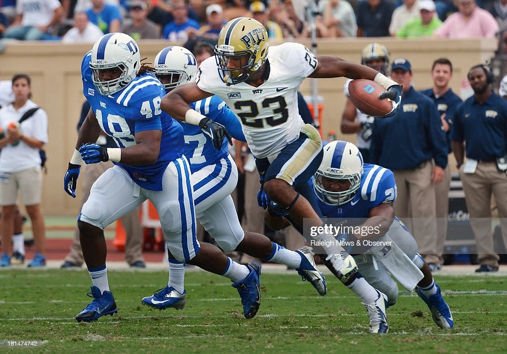 Pittsburgh wide receiver Tyler Boyd (23) tries to elude the Duke defense at Wallace Wade Stadium in Durham, North Carolina, on Saturday, September 21, 2013. Pitt held off Duke, 58-55.
