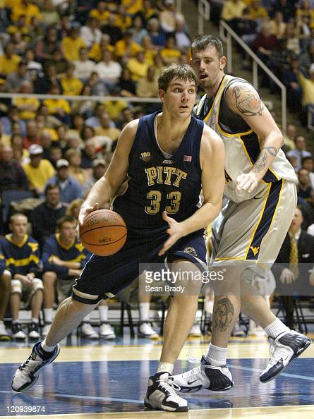 Pittsburgh's Aaron Gray drives on West Virginia's Kevin Pittsnogle during action at the WVU Coliseum in Morgantown West Virginia on February 27 2005