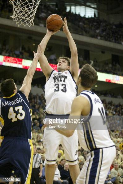 Pittsburgh's Aaron Gray shoots over Marquette's Ryan Amoroso at the Petersen Events Center Jan 28 2006 in Pittsburgh Pennsylvania
