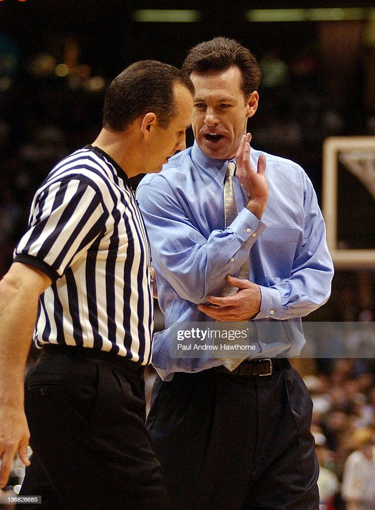 Pittsburgh's Head Coach <a gi-track='captionPersonalityLinkClicked' href=/galleries/search?phrase=Jamie+Dixon&family=editorial&specificpeople=234974 ng-click='$event.stopPropagation()'>Jamie Dixon</a> has a word with a referee during the first half of play at the Continental Airlines Arena in East Rutherford, New Jersey, March 25, 2004.