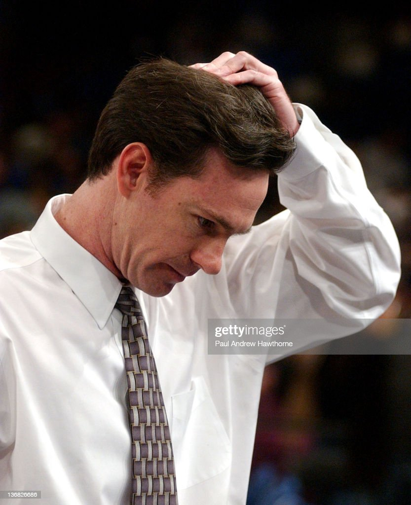 Pittsburgh's Head Coach <a gi-track='captionPersonalityLinkClicked' href=/galleries/search?phrase=Jamie+Dixon&family=editorial&specificpeople=234974 ng-click='$event.stopPropagation()'>Jamie Dixon</a> leaves the court after Pitts loss to Connecticut at Madison Square Garden in New York City, March 13, 2004, during the 2004 Big East Men's Basketball Championship finals game. UConn won with a final of 61-58.