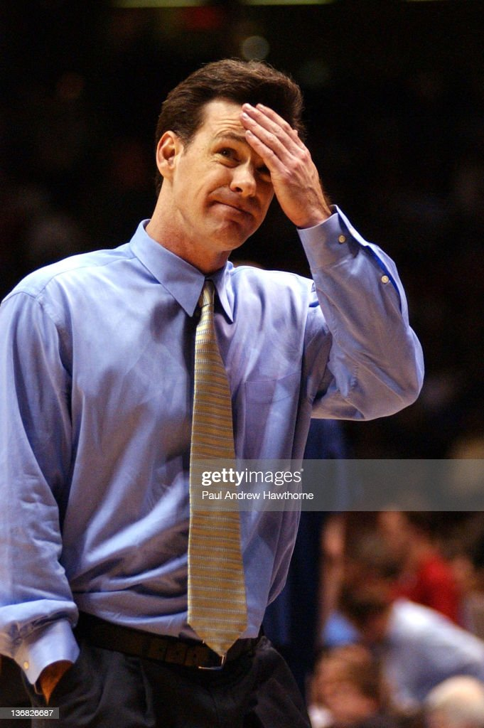 Pittsburgh's Head Coach <a gi-track='captionPersonalityLinkClicked' href=/galleries/search?phrase=Jamie+Dixon&family=editorial&specificpeople=234974 ng-click='$event.stopPropagation()'>Jamie Dixon</a> walks off the court after his Panthers loss to Oklahoma State at the Continental Airlines Arena in East Rutherford, New Jersey, March 25, 2004. Oklahoma State beat Pittsburgh with a final score of 63-51.