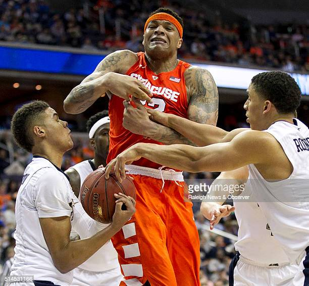 Pittsburgh's James Robinson and Cameron Johnson strip the ball away from Syracuse's DaJuan Coleman during the second half on Wednesday March 9 2016...