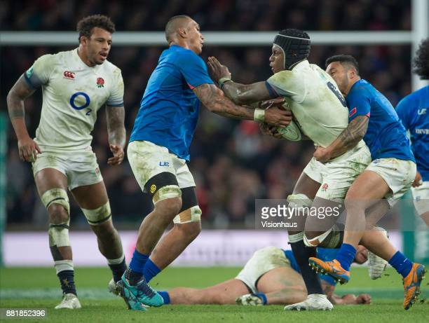 Piula Fa'asalele of Samoa attempts to rip the ball from Maro Itoje of England during the Old Mutual Wealth Series autumn international match between...