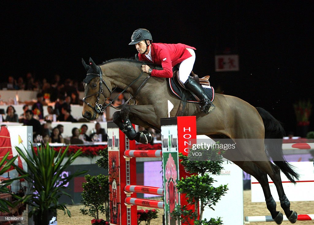 Pius Schwizer of Switzerland rides Verdi III at the Prix Artemide during the Longines Hong Kong Masters International Show Jumping at Asia World Expo on February 28, 2013 in Hong Kong, Hong Kong.