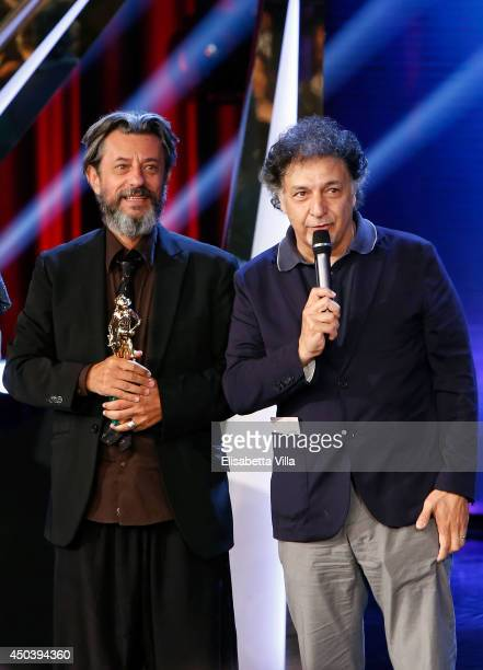 Pivio and Aldo De Scalzi receive the best composer award for 'Song'e Napule' as they attend the David Di Donatello Awards Ceremony at the Dear...