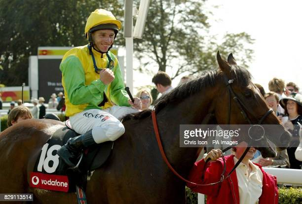 Pivotal Point with jockey Seb Sanders after winning the Vodafone Stewards' Cup at the Glorious Goodwood festival near Chichester West Sussex Saturday...