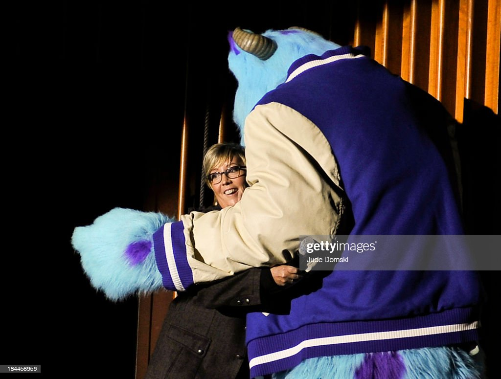Pixar character James P. Sullivan ('Sulley') from the animated films 'Monsters, Inc' and 'Monsters University' with Pixar Producer Kori Rae on stage at Hopkins Center Spaulding Auditorium during 'A Tribute to Pixar' on October 13, 2013 in Hanover, New Hampshire.