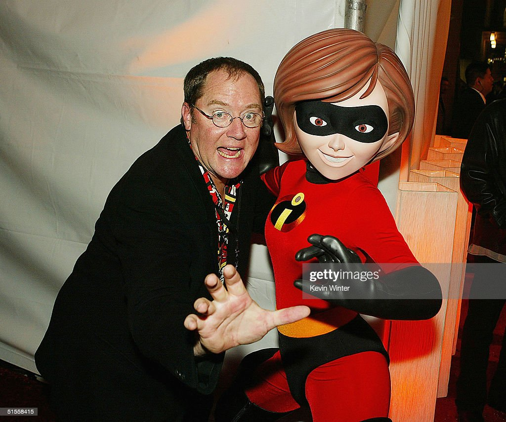 Pixar's John Lasseter and 'Elastigirl' character arrive at the afterparty for the premiere of Disney's 'The Incredibles' at the El Capitan Theatre on...