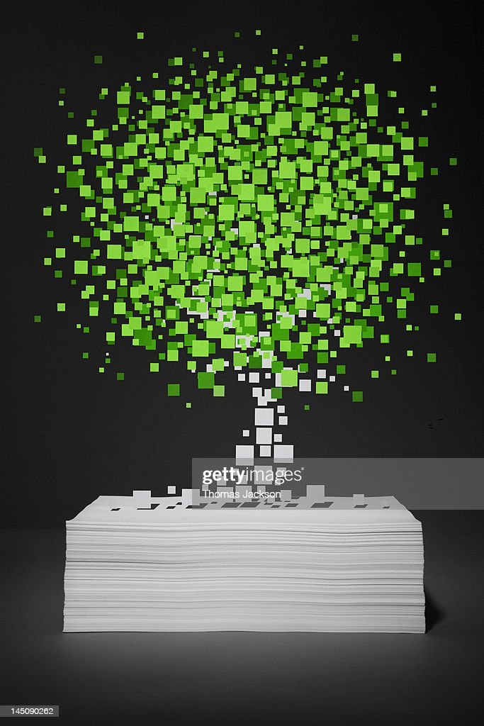 Pixel tree growing from stack of paper : Stock Photo