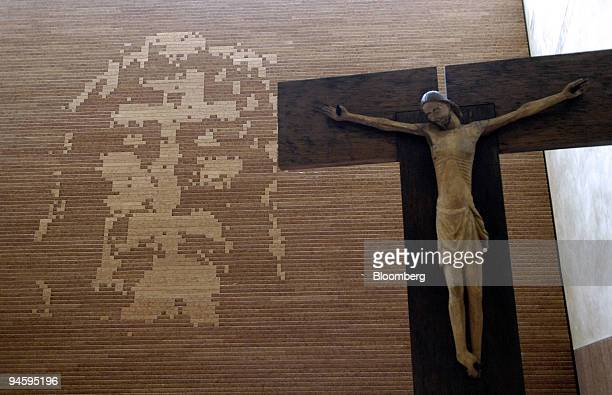 A pixelated image of the face of Christ taken from the mysterious image on the Turin Shroud hangs behind the alter inside the church of Santo Volto...