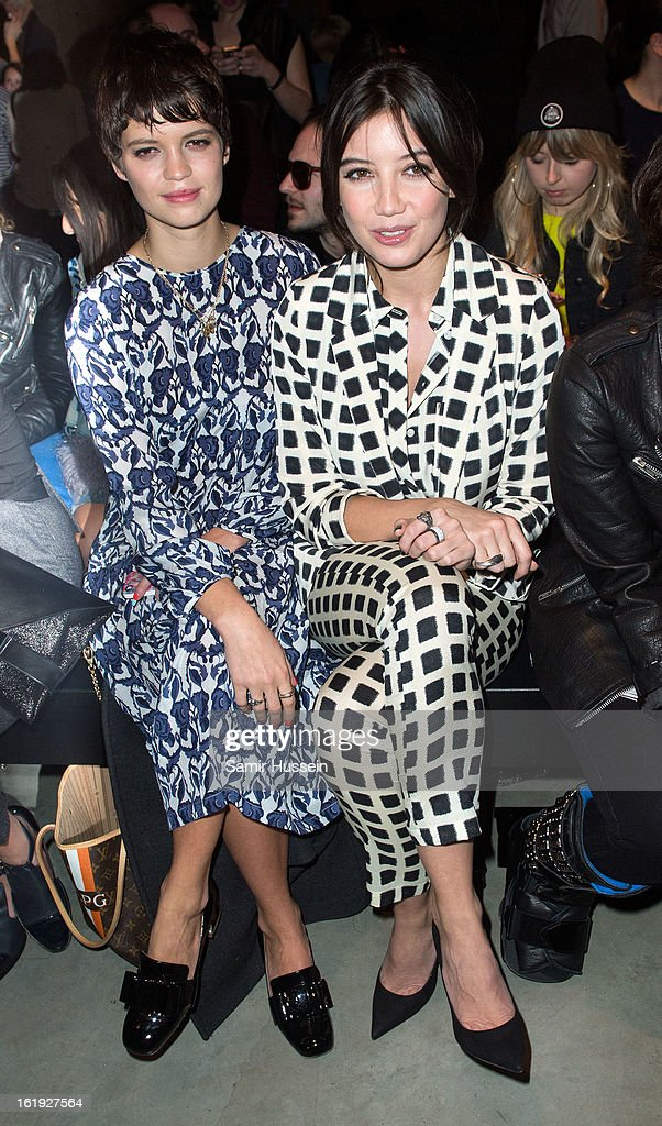 Pixie Geldof and Daisy Lowe (R) attend the Topshop Unique show at the Tate Modern during London Fashion Week Fall/Winter 2013/14 on February 17, 2013 in London, England.