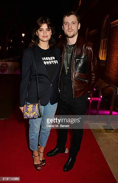 Pixie Geldof and George Barnett attend a private view of 'The Rolling Stones Exhibitionism' at The Saatchi Gallery on April 4 2016 in London England