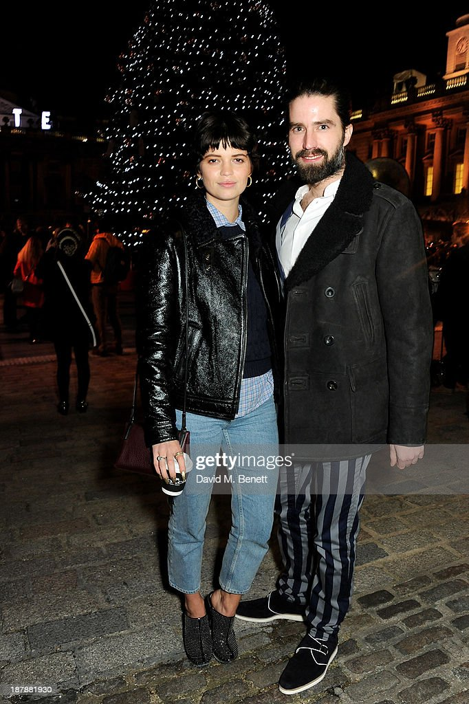 Pixie Geldof (L) and Jack Guinness attend the VIP launch of 'Coach Presents Skate' at Somerset House on November 13, 2013 in London, England.