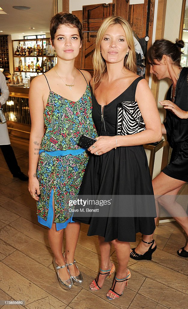 Pixie Geldof (L) and Kate Moss attend a first look at a new range of tech accessories for Carphone Warehouse, designed exclusively by Kate Moss for the high street brand, at The Club at The Ivy on July 18, 2013 in London England. The range of smartphone and tablet accessories goes on sale nationwide later this month.
