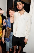 Pixie Geldof and Lev Tanju attend the Palace Skateboards x Reebok collaboration launch party at the Victorian Vaults on July 11 2013 in London England
