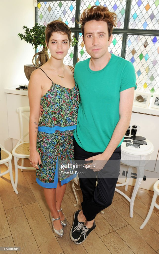 Pixie Geldof (L) and Nick Grimshaw attend a first look at a new range of tech accessories for Carphone Warehouse, designed exclusively by Kate Moss for the high street brand, at The Club at The Ivy on July 18, 2013 in London England. The range of smartphone and tablet accessories goes on sale nationwide later this month.