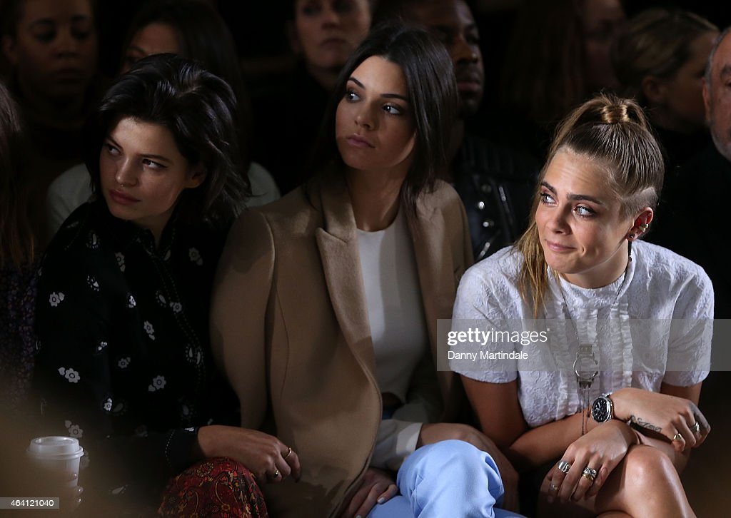 Pixie Geldof, Kendall Jenner and Cara Delevingne watch the TopShop unique show during London Fashion Week Fall/Winter 2015/16 on February 22, 2015 in London, United Kingdom.