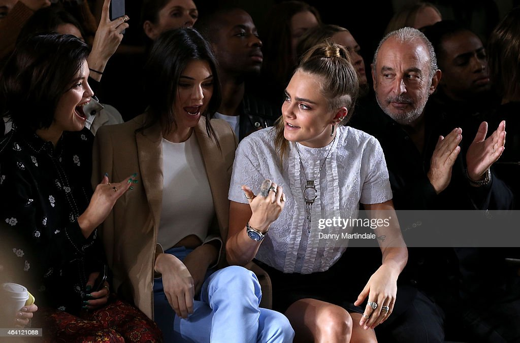 Pixie Geldof, Kendall Jenner, Cara Delevingne and Sir Philip Green watch the TopShop unique show during London Fashion Week Fall/Winter 2015/16 on February 22, 2015 in London, United Kingdom.
