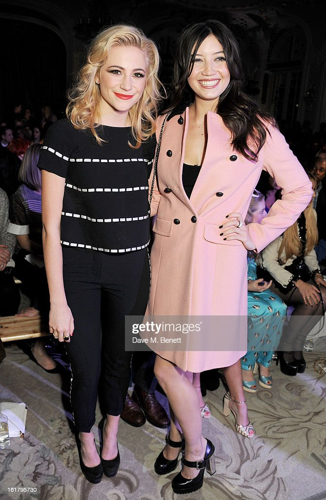 Pixie Lott (L) and Daisy Lowe attend the Moschino cheap&chic show during London Fashion Week Fall/Winter 2013/14 at The Savoy Hotel on February 16, 2013 in London, England.
