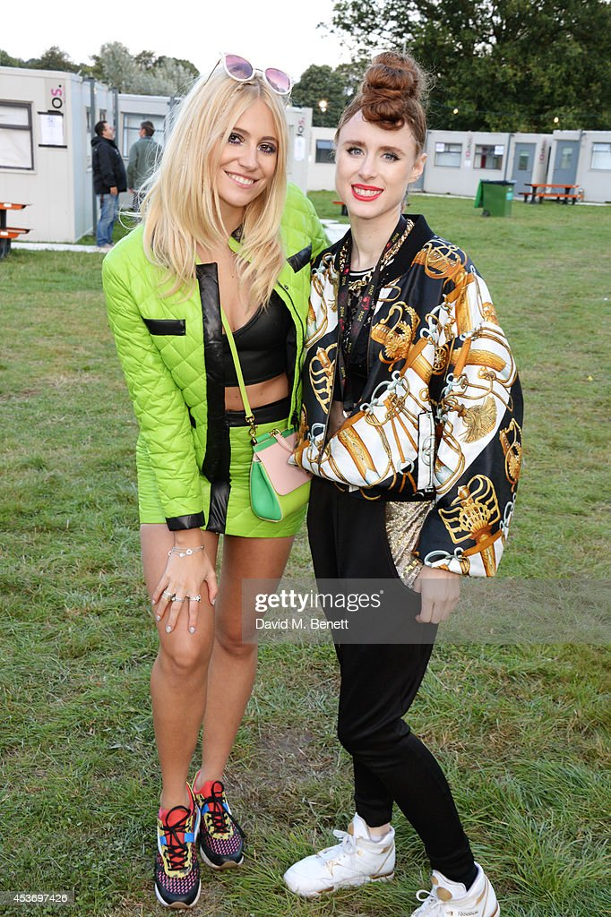 Pixie Lott (L) and Kiesza attend the Mahiki Rum Bar for the launch of the Mahiki Rum Family backstage during day 1 of the V Festival 2014 at Hylands Park on August 16, 2014 in Chelmsford, England.