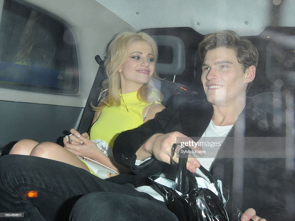 Pixie Lott and Oliver Cheshire at Burberry Regent Street on January 31, 2013 in London, England.