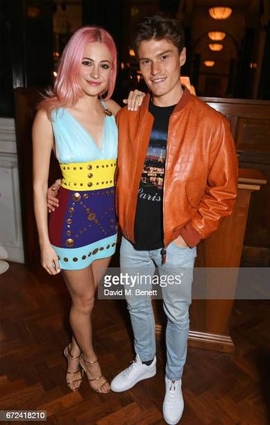 Pixie Lott and Oliver Cheshire attend a preopening dinner hosted by Ed Drewett at Malibu Kitchen at The Ned London on April 24 2017 in London England