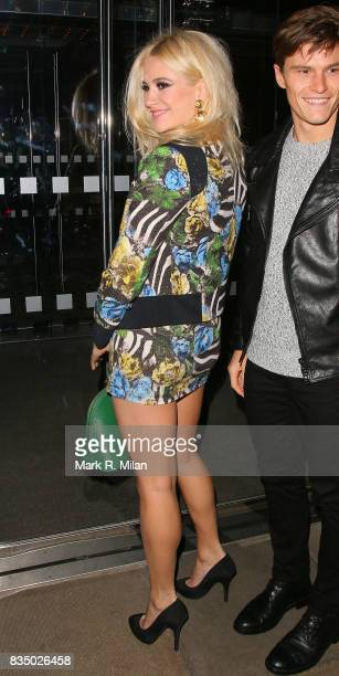 Pixie Lott and Oliver Cheshire attend the GUESS Loves Priyanka VIP Dinner at the London Edition Hotel on January 20 2014 in London England