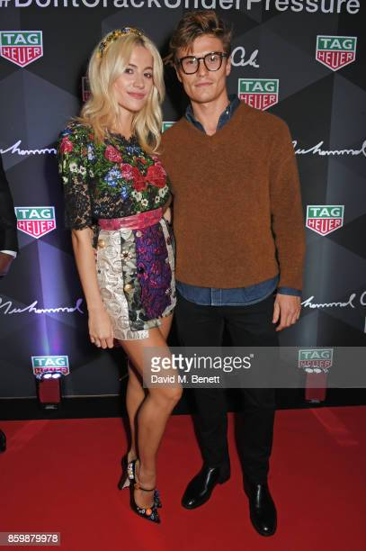 Pixie Lott and Oliver Cheshire attend the launch of the TAG Heuer Muhammad Ali Limited Edition Timepieces at BXR Gym on October 10 2017 in London...
