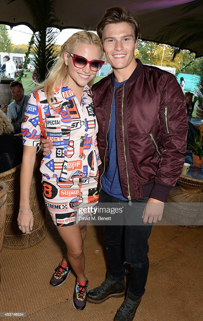 Pixie Lott (L) and Oliver Cheshire attend the Mahiki Rum Bar for the launch of the Mahiki Rum Family backstage during day 2 of the V Festival 2014 at Hylands Park on August 17, 2014 in Chelmsford, England.
