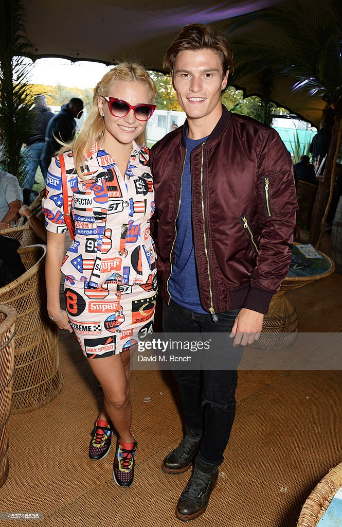 <a gi-track='captionPersonalityLinkClicked' href=/galleries/search?phrase=Pixie+Lott&family=editorial&specificpeople=5591168 ng-click='$event.stopPropagation()'>Pixie Lott</a> (L) and <a gi-track='captionPersonalityLinkClicked' href=/galleries/search?phrase=Oliver+Cheshire&family=editorial&specificpeople=7407100 ng-click='$event.stopPropagation()'>Oliver Cheshire</a> attend the Mahiki Rum Bar for the launch of the Mahiki Rum Family backstage during day 2 of the V Festival 2014 at Hylands Park on August 17, 2014 in Chelmsford, England.